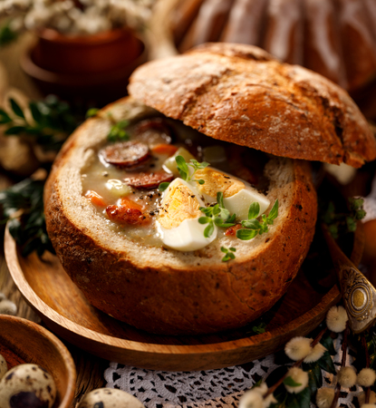 The sour soup made of rye flour with smoked sausage. Traditional polish sour rye soup, a popular Easter dish