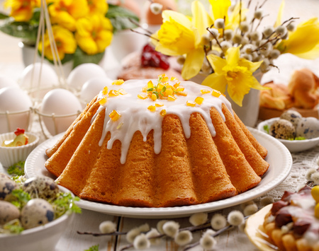 Easter yeast cake with icing and candied orange peel, delicious Easter dessert, traditional Easter pastries in Poland