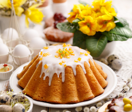 Easter yeast cake with icing and candied orange peel, delicious Easter dessert, traditional Easter pastries in Poland Standard-Bild