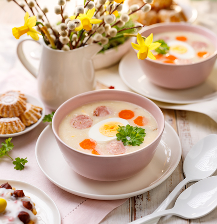 Polish Easter soup, white borscht with a sausage and a hard boiled egg. Traditional Easter dish in Poland