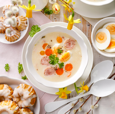 Polish Easter soup, white borscht with sausage and a hard boiled egg, top view. Traditional Easter dish in Poland