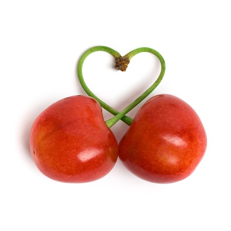 Heart chape from two cherries on a white background Standard-Bild