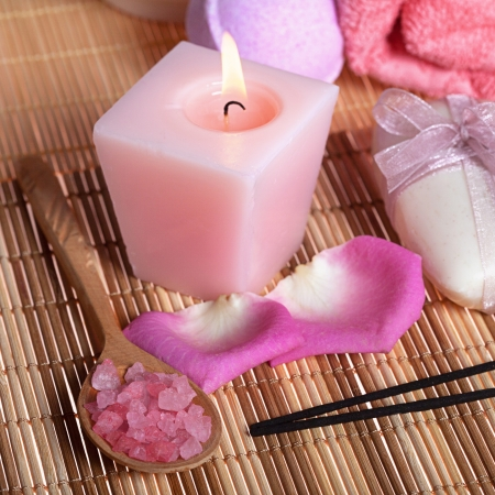 Spa treatment  sea salt, candle, soap, roses petals and aroma sticks photo