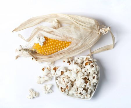 Corn on the cob and pop corn on a white background Standard-Bild