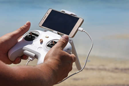 Hands with drone remote controller