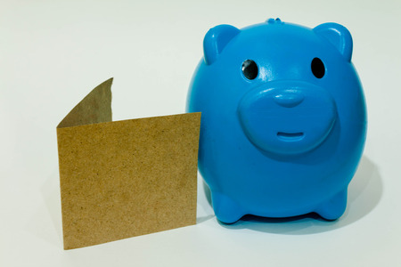 money box: Blue piggy bank or money box isolated on a white  background . Stock Photo