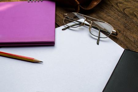 sketchbook: Sketchbook or Notebook with Pencil on Old Wooden Table .