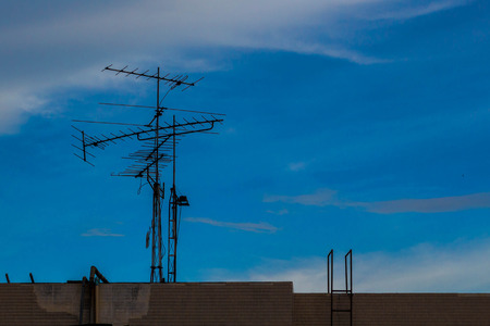 transmit: Television antenna with blue sky background,TV antennas on buildings clear day. Stock Photo