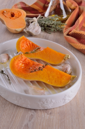 quartered: Two quarters pumpkin on a white plate