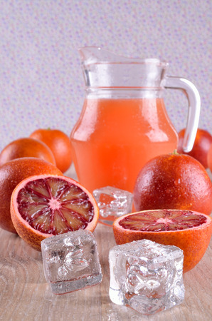 transparent ice cubes lying on a background of citrus fruits photo