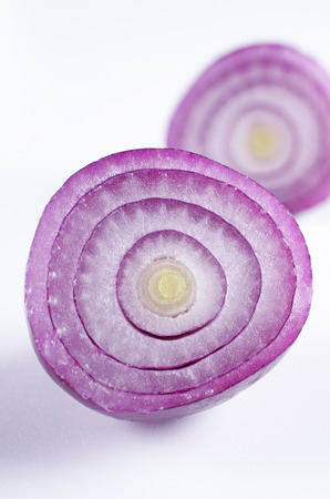 half cut: Half cut red onion on white background  Stock Photo