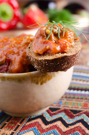 caviar red color of vegetables, lying on dark bread photo