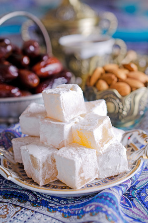 Traditional tea party in Arabic with dates, sweets and nuts