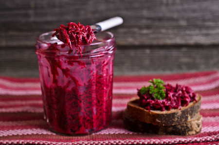 Sandwich with beet and parsley on a wooden Board photo