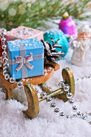 Christmas composition with Christmas decorations, gifts and snow photo