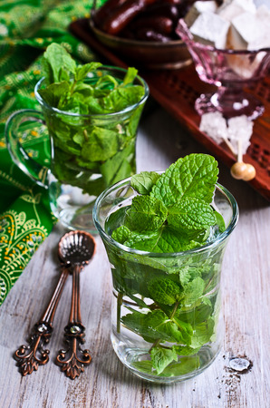 Traditional Oriental tea with mint leaves in a glass photo