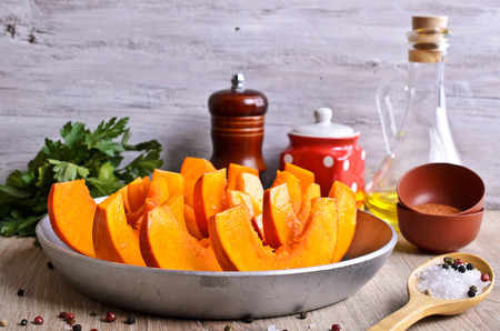 Raw chunks of pumpkin, prepared for cooking photo