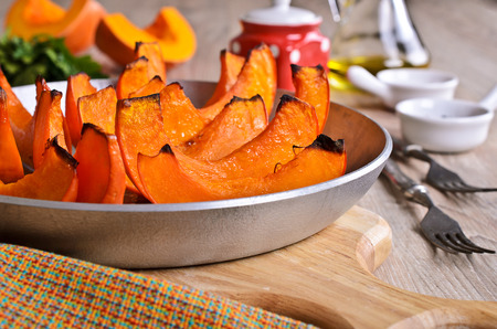Baked pieces of pumpkin in the form for making photo