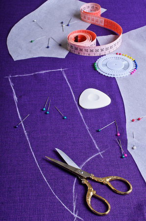 The outline on the fabric purple painted white chalk