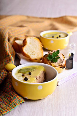 Pate covered with fat portions ceramic form yellow photo