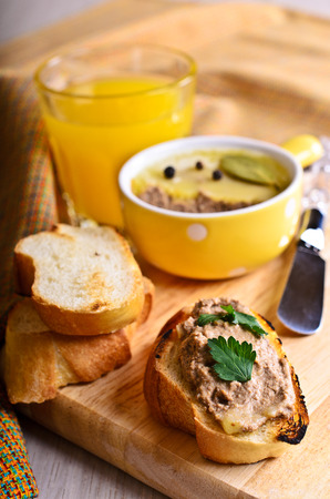 Sandwich with meat pate on a wooden board photo