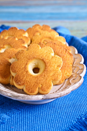 ramzan: Butter biscuits brown color in the form of a flower on a blue background