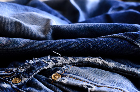 blue jeans: Background of denim blue color with scuffs items Stock Photo