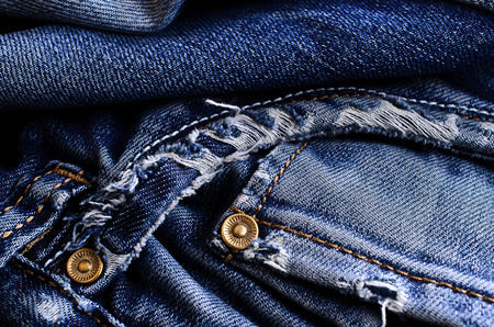 Background of denim blue color with scuffs items Imagens