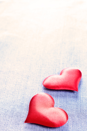 The background for Valentines Day. Abstraction of denim and hearts of the fabric. photo