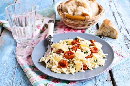Pasta with sun dried tomatoes, cheese and thyme in rustic style Archivio Fotografico