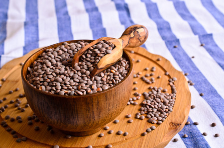 Dry seeds green lentils in a wooden bowl photo