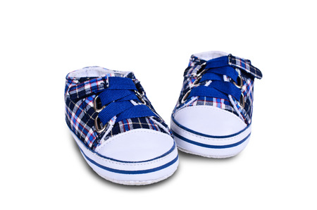 new born baby boy: Pair of childrens shoes on an isolated background Stock Photo