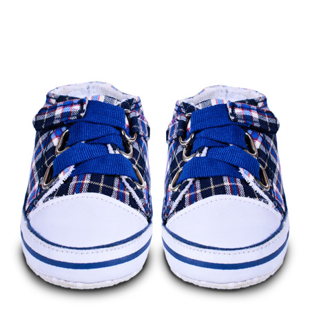 Pair of childrens shoes on an isolated background photo