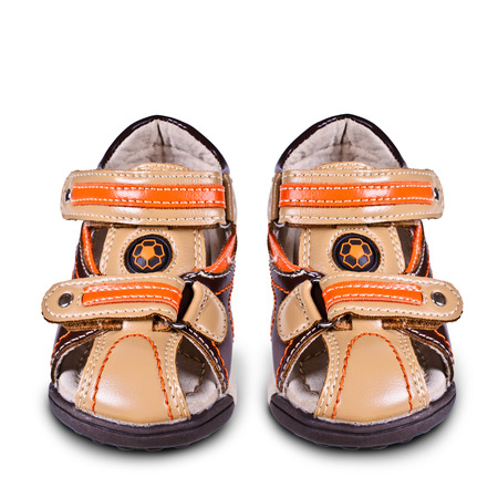Childrens sandals out of leather on an isolated background photo