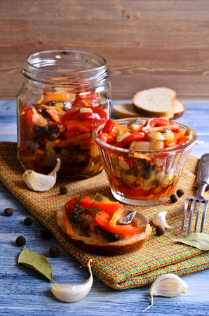 Sandwich with canned vegetables on wooden background surfaces