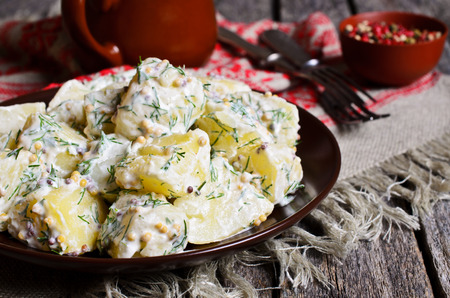 filling in: Potato salad with mustard seeds and white filling in rustic style Stock Photo