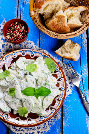 cucumber salad: Cucumber salad with dill and mint in a yogurt dressing