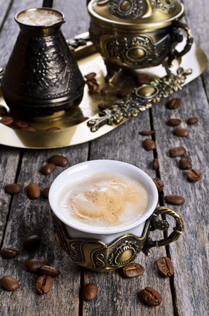 crema: Brewed coffee with Crema in the Cup on a wooden surface in rustic style Stock Photo