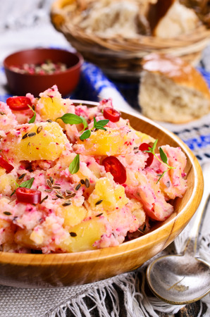 potato salad: Potato salad with thyme and chilli pepper in wooden bowl