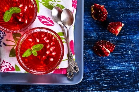 gelatine: Jelly red with pomegranate and mint in a glass container