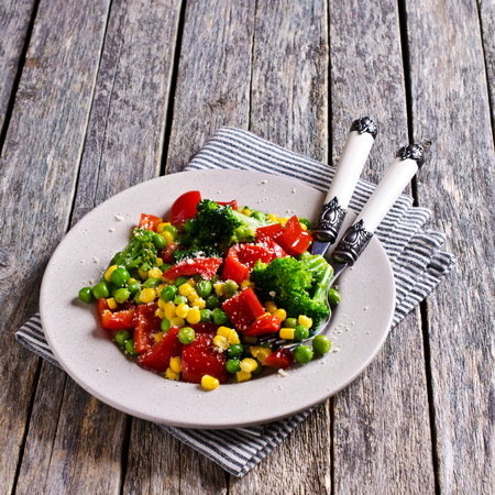 fresh vegetable: Cooked colorful vegetables, sprinkled with cheese. Selective focus. Stock Photo