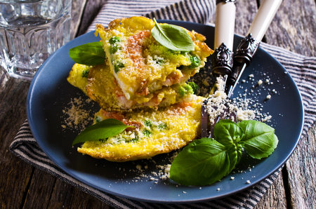 Omelet with shrimp and peas in a rustic style. Selective focus. Archivio Fotografico