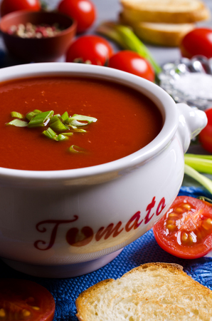 tomato puree: Tomato puree the soup in a ceramic pot on a wooden background. Selective focus. Stock Photo