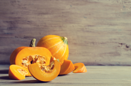 pumpkins: Pumpkin slices with seeds on a wooden background. Selective focus.
