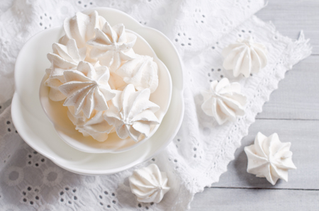 kiss biscuits: White sweet meringue traditional form. Selective focus.