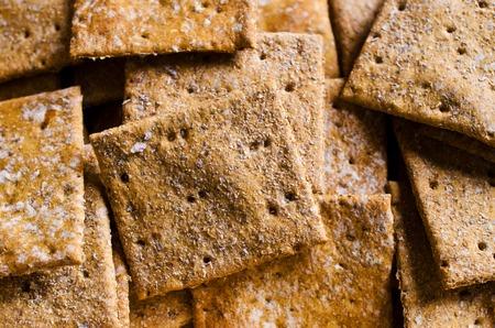 bran: Cracker square shape with bran. Selective focus.
