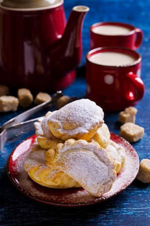 rustic food: Traditional Arabic cookies with filling, sprinkled with powdered sugar. Selective focus. Stock Photo