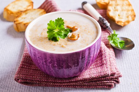 Soup with mushrooms and cream in a bowl. Selective focus. Archivio Fotografico