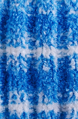 knitwear: Background of blue handmade knitwear. Selective focus.