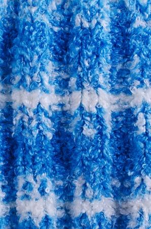 knitwear: Background of blue handmade knitwear. Selective focus.